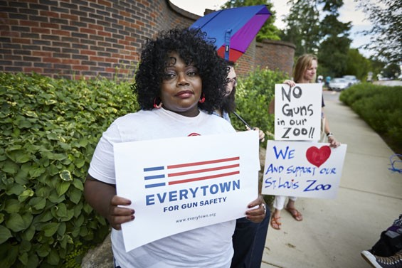 A protester outside the St. Louis Zoo - PHOTO BY THEO WELLING