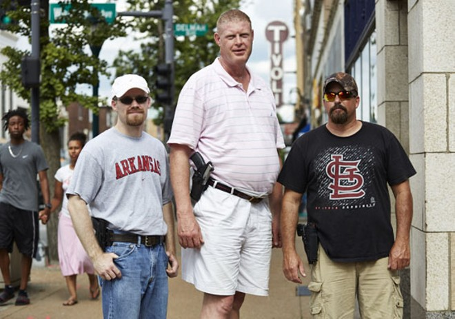 Jeffry Smith (center) with two fellow gun advocates, packing heat on the Delmar Loop. - PHOTO BY THEO WELLING