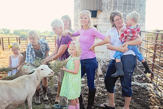 Leslie Moore and friends on the farm. | Compliments of Farmer Girl Meats