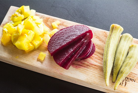 """""""Southern Pickled Vegetables"""" features sweet green tomatoes, pickled beets and okra."""