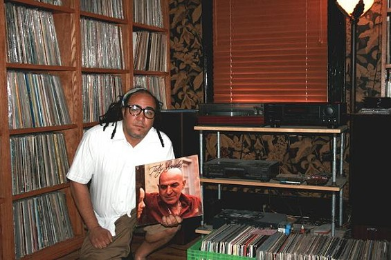 Doug Morgan's record collection, which includes this Telly Savalas gem - JON SCORFINA