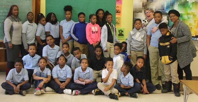 The fourth graders with homeroom teacher Bertha Hamilton (far left), art teacher Britt Tate-Beaugard (fourth from right) and Dr. Karen Bradford (far right). - SARAH FENSKE