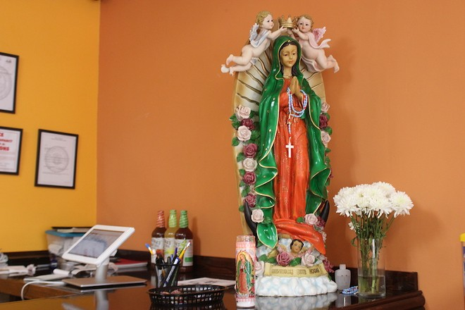 The Blessed Virgin keeps a watchful eye on the dining room. - SARAH FENSKE