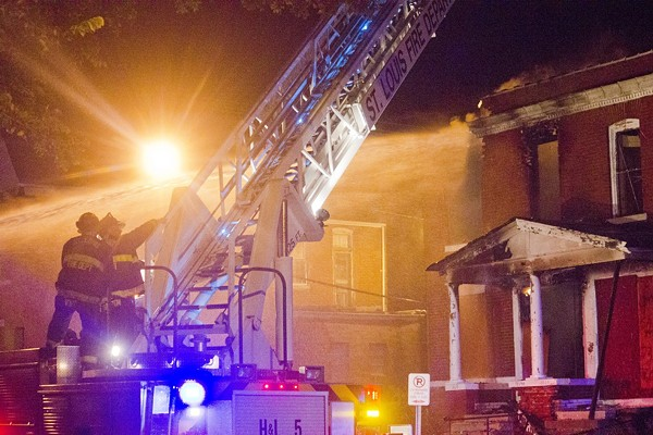 Fires burned on August 19 — and stores were looted. - PHOTO BY DANNY WICENTOWSKI
