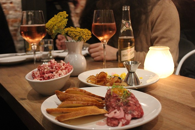 Beef tartare and beet powder-flavored popcorn are among the appetizers at Pop. - SARAH FENSKE