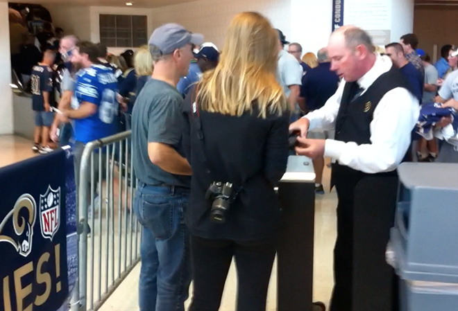 A screenshot of a video Kraus took of his spin-move at the Rams' final Opening Day in St. Louis. He slipped between the turnstile and the metal fence to the left, then ran around the fence and up the stairs.