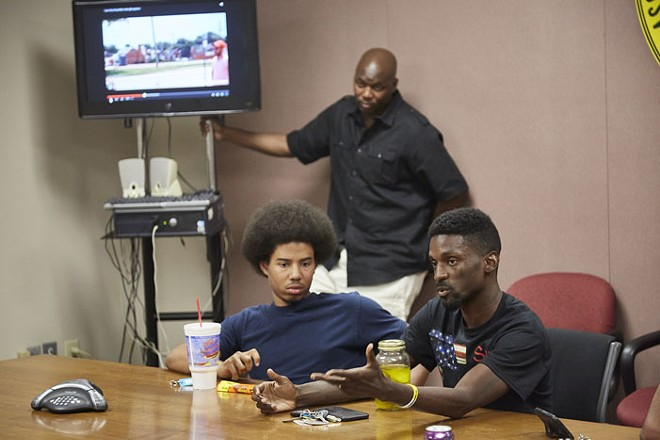Franks, right, argues a point to a police minority-recruitment class as instructor Sgt. Bill Clinton stands in the background. - STEVE TRUESDELL