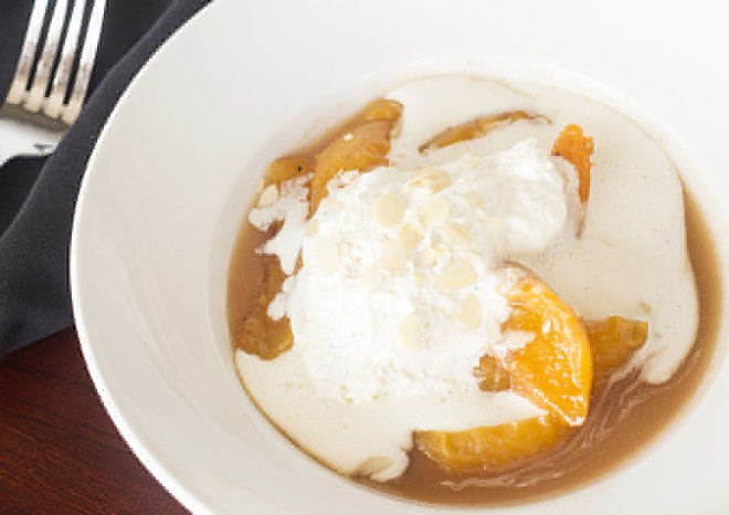 Caramelized peaches topped with whipped cream and toasted almonds. - MABEL SUEN