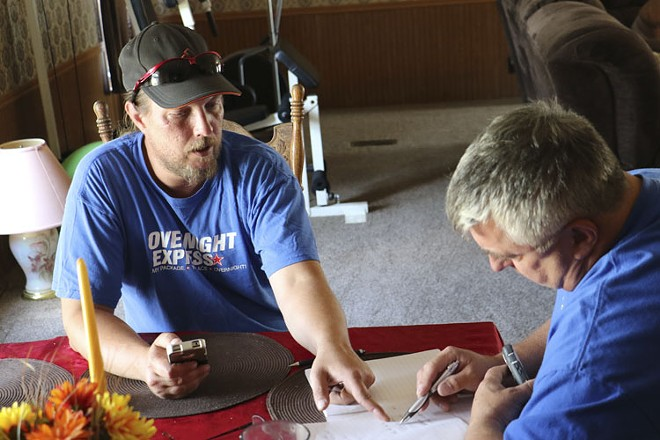 Chris and Mike Mizanskey organize media contacts who've asked to speak with Jeff. - RAY DOWNS