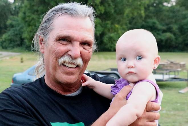 Mizanskey with his great-granddaughter, Aria McReaken. - RAY DOWNS