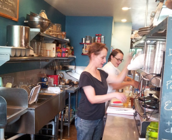 Co-owners Rachel Moeller (foreground) and Colleen Clawson work their milktoast magic. - PHOTO BY KATIE INEICH