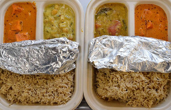 Curry Club's lunch special features two types of curry, a choice of rice and naan wrapped in tin foil. - TOM HELLAUER