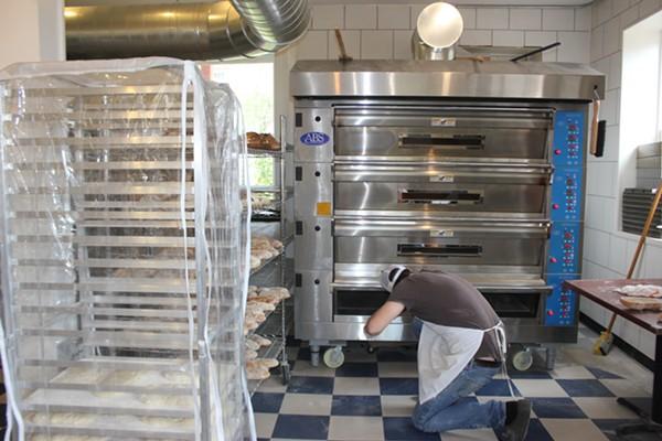Ted Wilson prepares the day's bread. - CHERYL BAEHR