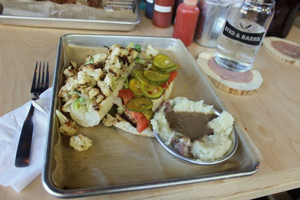 The cauliflower Po Boy with mashed potatoes and mushroom gravy on the side. - PHOTO BY LAUREN MILFORD
