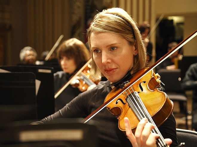 The Saint Louis Symphony Orchestra's string section. - PHOTO BY SCOTT FERGUSON