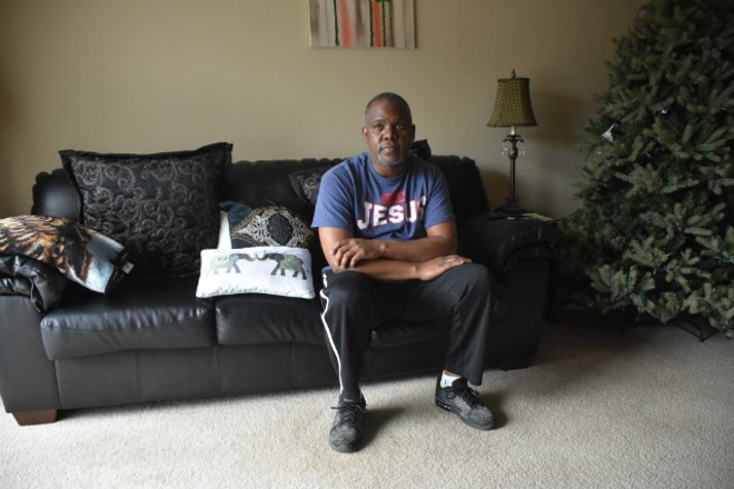 Steve Miller sits in an empty apartment after his wife was detained by ICE. - DOYLE MURPHY