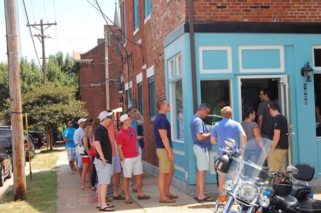 A line outside Tropical Liqueurs on its opening weekend. - PHOTO BY KRISTIE MCCLANAHAN