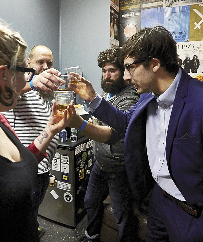 A pre-performance toast. - PHOTO BY THEO WELLING