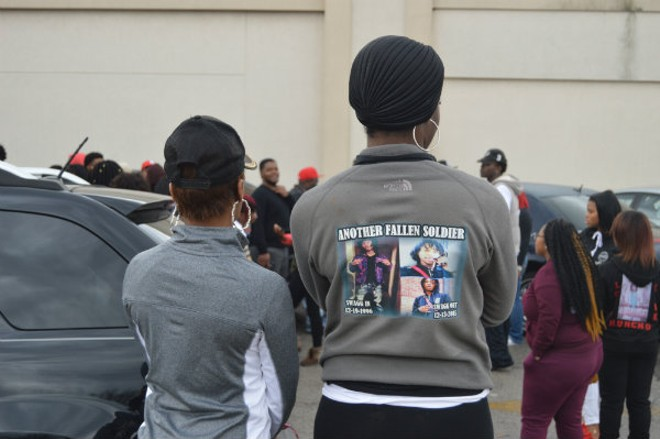 A mourner outside the funeral for James Johnson Jr. - ALL PHOTOS BY BEN WESTHOFF