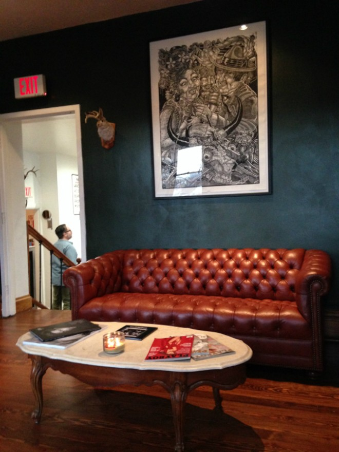 The waiting room at Union Barbershop is a tongue-in-cheek lounge, augmented by taxidermy and copies of Playboy. - DOYLE MURPHY