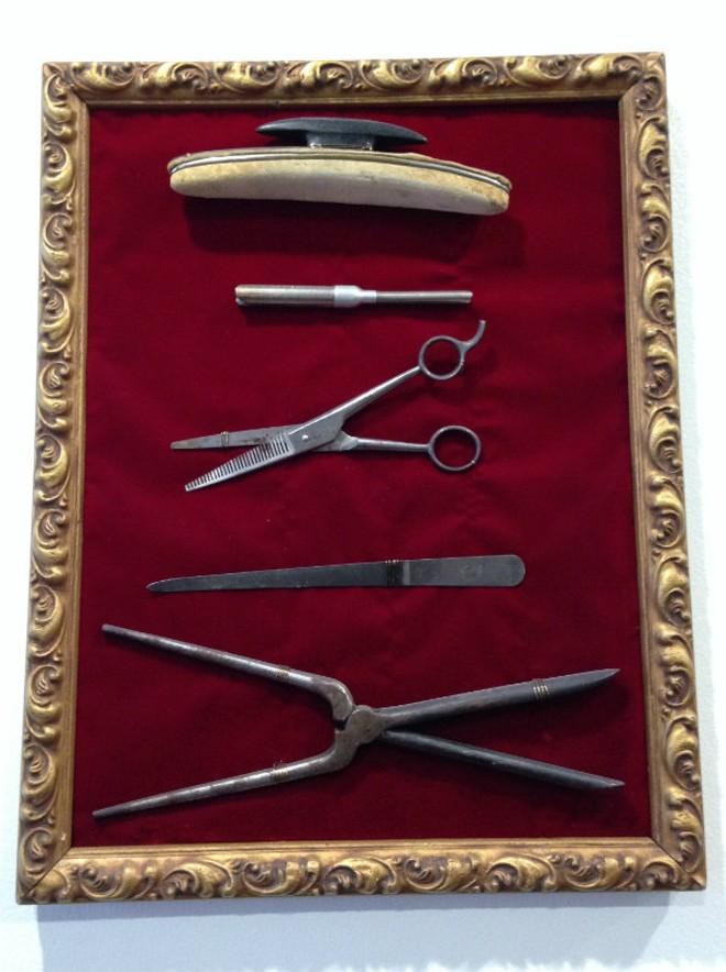 Throwback barbering tools hang as artwork in Union Barbershop in Soulard. - DOYLE MURPHY