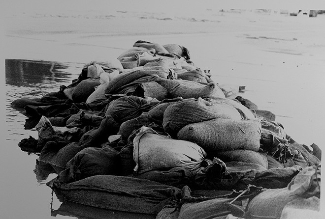 Sandbags hold the river at bay ... barely. - PHOTO BY BRIAN CHILSON