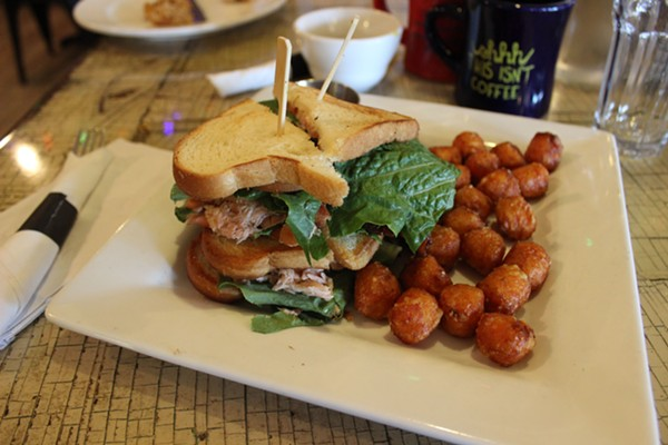 """Up in the club"" smoked salmon and bacon sandwich with sweet potato tots. - PHOTO BY LAUREN MILFORD"