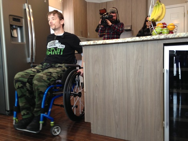 Chris Sanna tours his renovated home for the first time since he was partially paralyzed in a St. Louis shooting. - DOYLE MURPHY
