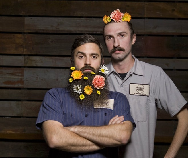 Quality Assurance Specialist Kyle Tavares and Brand Specialist Will Rogers are dazzling with May flowers. - PHOTO BY KATE BURRUS