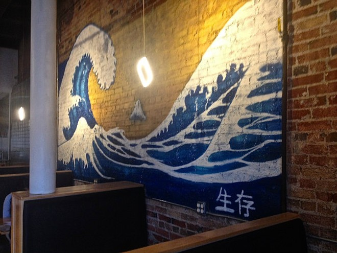 The tsunami mural brings bright colors to the wall at Midtown Sushi. - EMILY HIGGINBOTHAM
