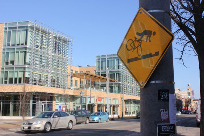 These new signs warn cyclists near the trolley tracks, which run the length of Delmar in the Loop area. - PHOTO BY SARAH FENSKE