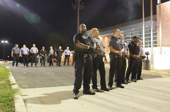 Officers stand guard over the Ferguson Police Department in September 2014 - PHOTO BY DANNY WICENTOWSKI