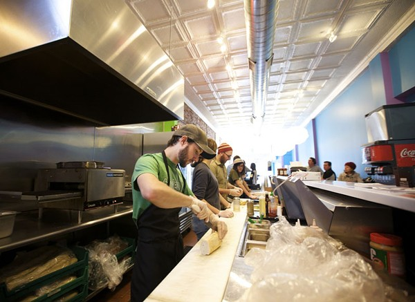 Snarf's staff at work in the Loop. - PHOTO BY JENNIFER SILVERBERG