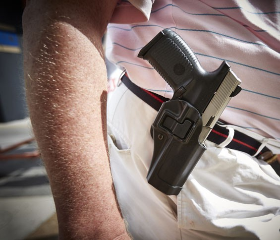 Open carry? Not if you're a felon. - PHOTO BY THEO WELLING