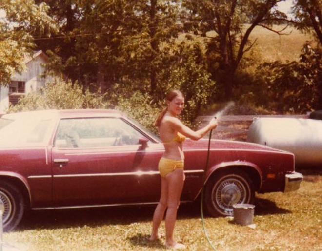 Judy washes her Oldsmobile, which was later found abandoned in a ditch on Route FF. - PHOTO COURTESY OF THE SPENCERS