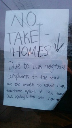 A sign at Tropical Liqueurs tells customers it won't serve to-go cups 'due to our neighbor's complaints to the state.' - PHOTO VIA BILLY TOMBER