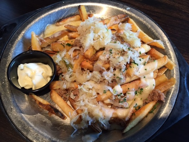 The German nachos are topped by hamburger and sauerkraut, then served with a side of mayo. - PHOTO BY SARAH FENSKE