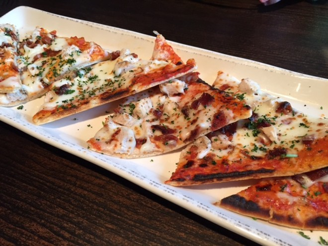 The American flatbread pizza comes with spicy blue cheese sauce, chicken and crispy bacon. - PHOTO BY SARAH FENSKE