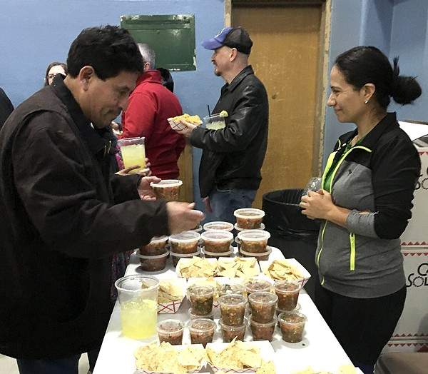 Volunteers do their best to keep customers happy and the line moving. - PHOTO BY KELLY GLUECK