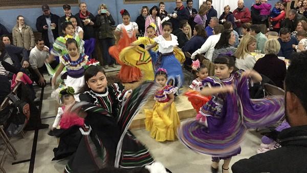Folk dancers entertain while you wait. - PHOTO BY KELLY GLUECK