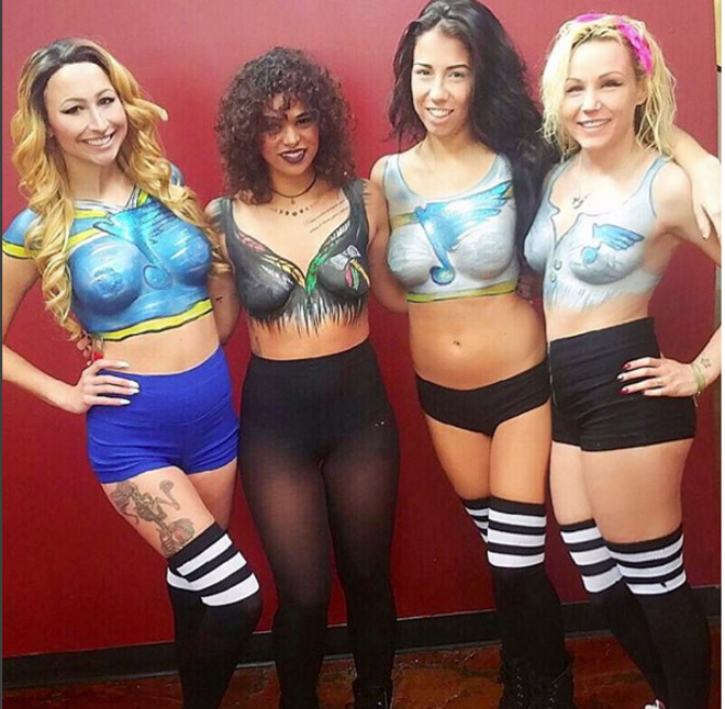 Servers at the Social House II show off the body paint the concept is known for. - PHOTO COURTESY OF INSTAGRAM/SOCIAL HOUSE