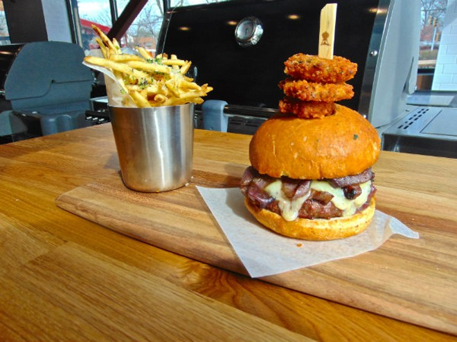 The Prime Kettle Burger is one of Weber's signature dishes and is made with a blend of prime back angus beef and cooked over a charcoal grill. - EMILY HIGGINBOTHAM