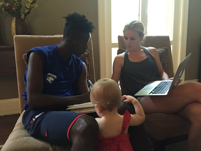 Jessica Herschend, with her toddler daughter, has taken in Saddiq and is tutoring him for a possible college career. - PHOTO COURTESY OF J.R. BIERSMITH