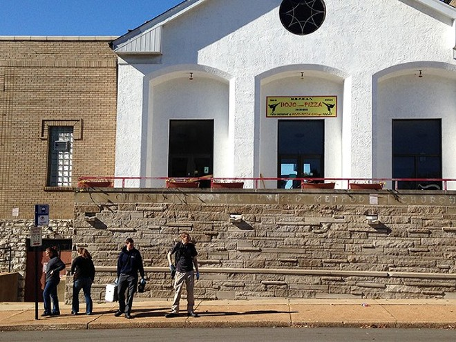 Federal agents leave Dojo Pizza on November 12 after one of several raids on the former Bevo Mill church. - DOYLE MURPHY