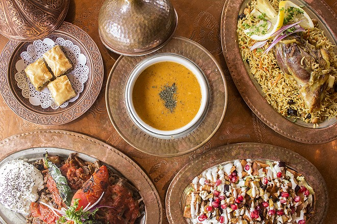 """A selection of dishes from Sheesh, including lamb biryani, baklava and the """"Sheesh Special"""" salad. - PHOTO BY MABEL SUEN"""