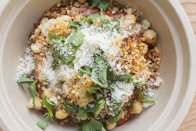 Farro, pomodoro sauce, seasonal vegetables, chick peas, grana padano, fresh herbs and crispy garlic. - PHOTO BY MABEL SUEN