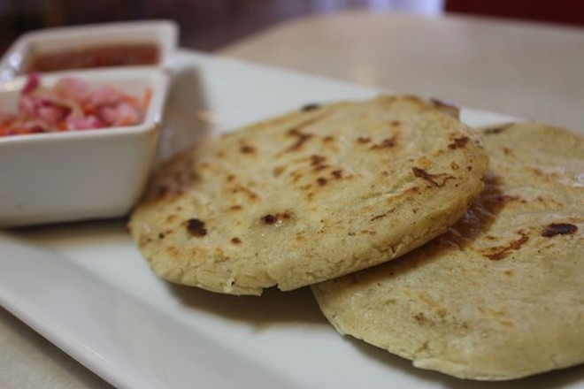 The pupusas, which come stuffed with Oaxacan cheese, are served with an intensely vinegary slaw on the side. - PHOTO BY SARAH FENSKE