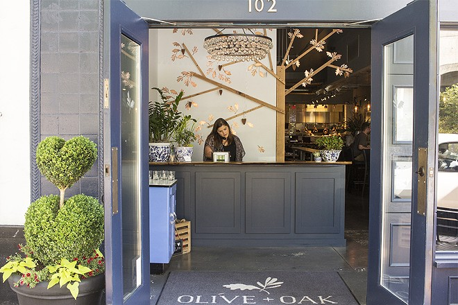 The space takes its name from the co-owner's sons, but also from the mighty olive and oak trees. - PHOTO BY MABEL SUEN