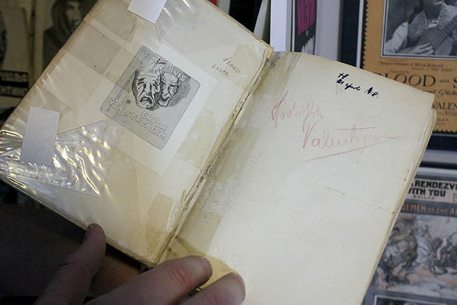 A book from Valentino's library, with his name handwritten inside. - PHOTO BY ALLISON BABKA