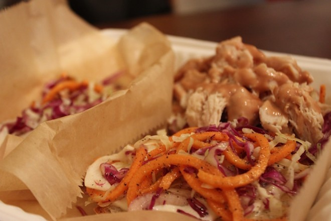 """Topped with soft smoked chicken and a cabbage slaw, """"Washington Avenue"""" sandwich comes on pretzel bread made with a base of sunflower seed flour. - PHOTO BY SARAH FENSKE"""